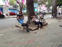 Street life in Saigon: Eating, playing and sleeping.