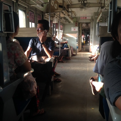 Dusky, open train trips through the outer skirts of Yangon